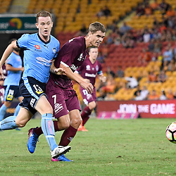 BRISBANE, AUSTRALIA - FEBRUARY 3: Thomas Kristensen of the Roar passes the ball under pressure from Brandon O'Neill of Sydney during the round 18 Hyundai A-League match between the Brisbane Roar and Sydney FC at Suncorp Stadium on February 3, 2017 in Brisbane, Australia. (Photo by Patrick Kearney/Brisbane Roar)