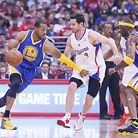 21 April 2014: Golden State Warriors forward Andre Iguodala (9) drives past Los Angeles Clippers guard J.J. Redick (4) during the Los Angeles Clippers 138-98 victory over the Golden State Warriors, during Game Two of the Western Conference Quarterfinals of the NBA Playoffs, at the Staples Center, Los Angeles, California, USA.