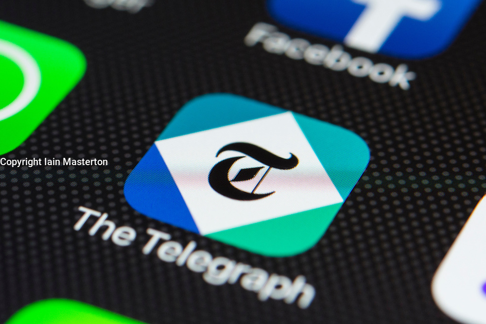 The Telegraph online digital newspaper app close up on iPhone smart phone screen