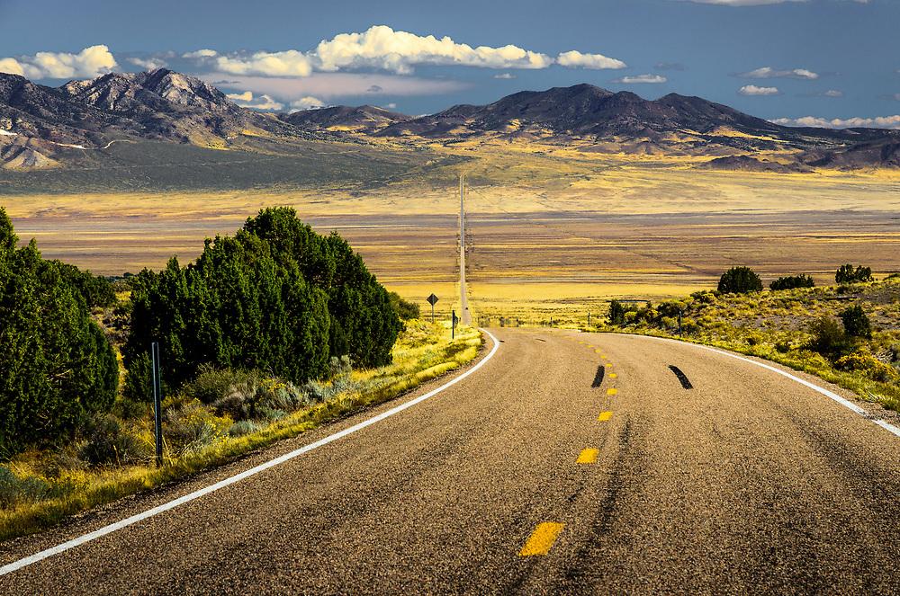 UT-21 leading to Wah Wah mountains in Utah.