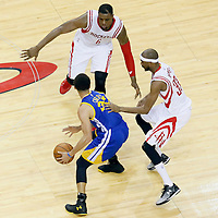 23 May 2015: Houston Rockets forward Terrence Jones (6) and Houston Rockets guard Corey Brewer (33) defend on Golden State Warriors guard Stephen Curry (30) during the Golden State Warriors 115-80 victory over the Houston Rockets, in game 3 of the Western Conference finals, at the Toyota Center, Houston, Texas, USA.