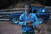 Kelabit man with gun and fourwheel drive vehicle. Sedentary Dayaks, living in longhouses, they rely on fishing, hunting and farming to survive. Limbang, Sarawak, Malaysia 2015<br /><br />Borneo native peoples and their rainforest habitat revisited two decades later: 1989/1991 and 2012/2014/2015. <br /> <br /> Sarawak's primary rainforests have been systematically logged over decades, threatening the sustainable lifestyle of its indigenous peoples who relied on nomadic hunter-gathering and rotational slash & burn cultivation of small areas of forest to survive. Now only a few areas of pristine rainforest remain; for the Dayaks and Penan this spells disaster, a rapidly disappearing way of life, forced re-settlement, many becoming wage-slaves. Large and medium size tree trunks have been sawn down and dragged out by bulldozers, leaving destruction in their midst, and for the most part a primary rainforest ecosystem beyond repair. Nowadays palm oil plantations and hydro-electric dam projects cover hundreds of thousands of hectares of what was the world's oldest rainforest ecosystem which had some of the highest rates of flora and fauna endemism, species found there and nowhere else on Earth, and this deforestation has done irreparable ecological damage to that region