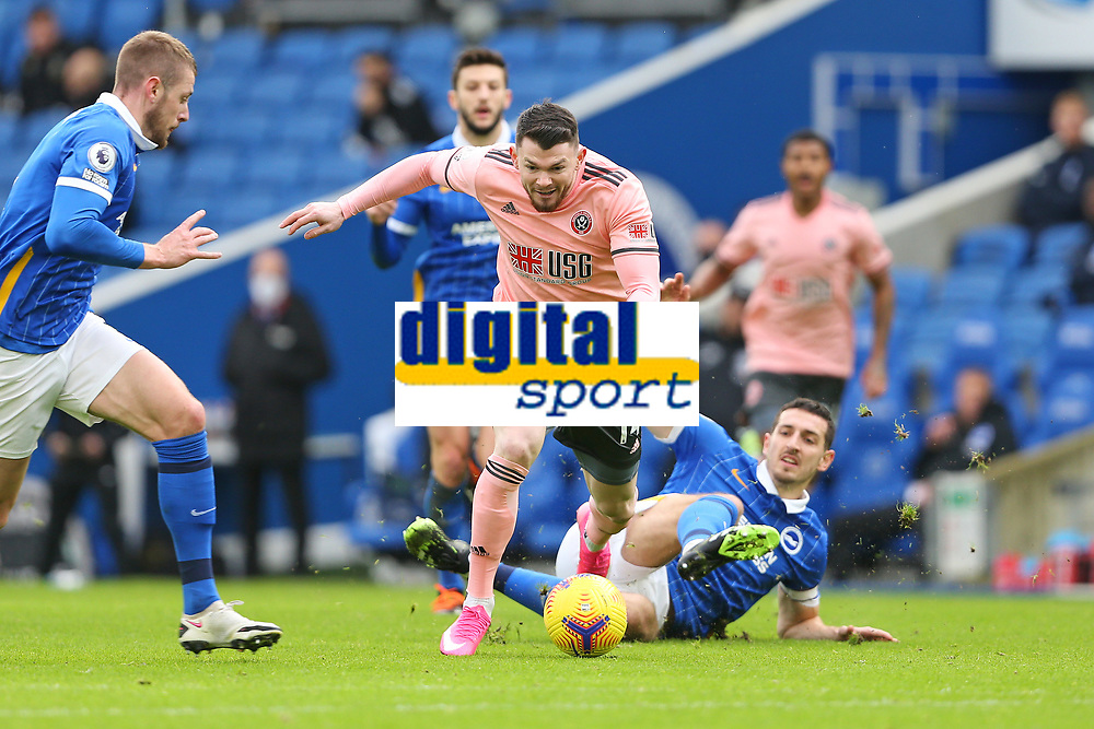 Football - 2020 / 2021 Premier League - Brighton and Hove Albion vs. Sheffield United - The Amex Stadium<br /> <br /> Lewis Dunk of Brighton fouls Oliver Burke of Sheffield United during the Premier League match at The Amex Stadium Brighton <br /> <br /> COLORSPORT/SHAUN BOGGUST