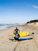 A couple of surf instructors prepare for their classes on Broadbeach, Queenland, Australia.