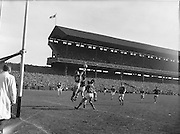 Kerry defenders O'Shea and Sheehy pressed hard by Galway forwards Nallen and Laide during the All Ireland Senior Gaelic Football Championship Final, Kerry vs Galway in Croke Park on the 27th September 1959. Kerry 3-7 Galway 1-4.