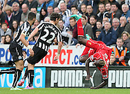 Mario Balotelli of Liverpool is up ended by Daryl Janmaat of Newcastle United - Barclays Premier League - Newcastle Utd vs Liverpool - St James' Park Stadium - Newcastle Upon Tyne - England - 1st November 2014  - Picture Simon Bellis/Sportimage