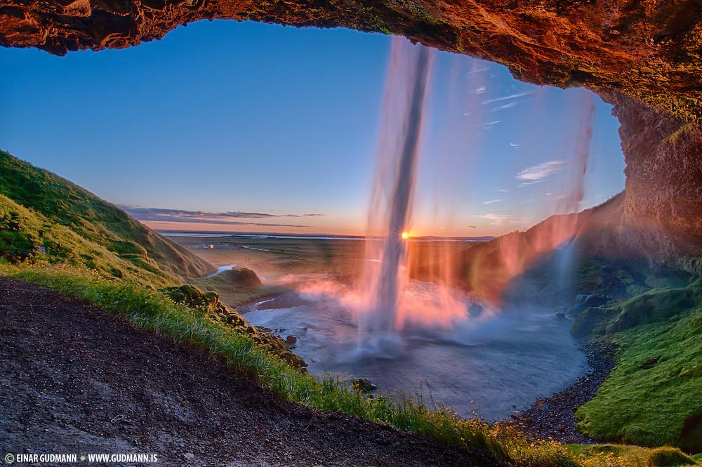 Sunset at Seljalandsfoss waterfall in South-Iceland.