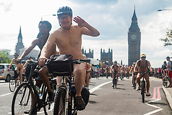 Westminster Bridge, London, June 11th 2016. Hundreds of naked and semi-naked cyclists participate in the World Naked Bike Ride that takes place in cities around the world, to highlight the alternatives to hydrocarbon fuels. PICTURED: The naked cyclists cross Westminster Bridge.