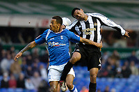 Photo: Leigh Quinnell.<br /> Birmingham City v Newcastle United. The FA Cup. 06/01/2007. Birminghams DJ Campbell jumps with Newcastles Nobby Solano.