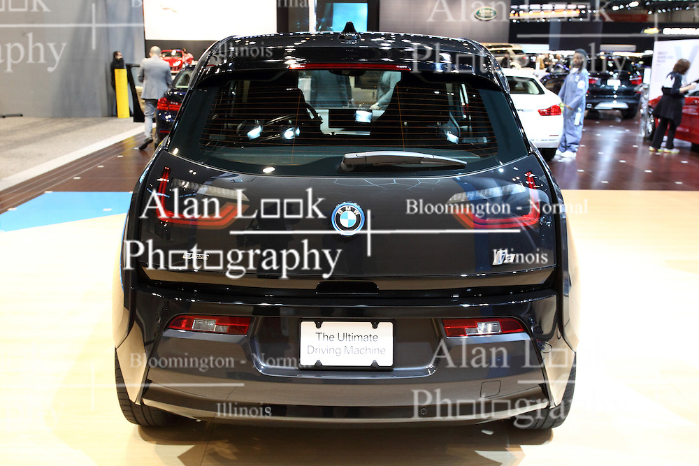 """12 February 2015: 2015 BMW i3: A must-see vehicle in the BMW exhibit during the 2015 Chicago Auto Show is the all-new  BMW i3 electric car, constructed in a revolutionary way from next-generation materials.  The i3 went on sale in the US market in the second quarter of 2014 as a 2015 model. This is BMW's first truly purpose-built electric car, and first vehicle to utilizing the new""""i sub-brand.  For 2015, the BMW i3 comes in three different worlds: Mega, Giga and Tera, all featuring LifeDrive architecture concept comprised of two modules; the Life Module, and the Drive Module. Think of the Life Module as the passenger cabin, or greenhouse. It is the first-ever mass produced Carbon Fiber Reinforced Plastic (CFRP) passenger cell in the automotive business. The Drive Module, which is constructed out of 100% aluminum, consists of the 22-kWh, 450 lb. lithium-ion battery, electric drive train, MacPherson strut and five-link rear suspension system and structural and crash components. The result is an electric car that weighs about 2,700 lbs (preliminary US figures). With the battery mounted in the rear, close to the drive wheels, the i3 gives impressive performance characteristics while also providing better traction.  Assisting the eDrive rear-wheel drive powertrain, are unique 19-inch tires that have low rolling resistance, and frame the light-alloy wheels. Offering a small turning circle of 32.3 feet, – a major benefit to driving in the city – the i3 still has a perfect 50-50 weight distribution.<br /> <br /> First staged in 1901, the Chicago Auto Show is the largest auto show in North America and has been held more times than any other auto exposition on the continent. The 2015 show marks the 107th edition of the Chicago Auto Show. It has been  presented by the Chicago Automobile Trade Association (CATA) since 1935.  It is held at McCormick Place, Chicago Illinois"""