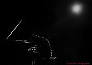 Legendary jazz pianist John Coates Jr. is backlit in concert in Stroudsburg, Pa..<br /> - Photography by Donna Fisher<br /> - ©2020 - Donna Fisher Photography, LLC <br /> - donnafisherphoto.com