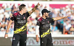 Somerset's Jamie Overton with team-mate Lewis Gergory<br /> <br /> Photographer Simon King/Replay Images<br /> <br /> Vitality Blast T20 - Round 1 - Somerset v Gloucestershire - Friday 6th July 2018 - Cooper Associates County Ground - Taunton<br /> <br /> World Copyright © Replay Images . All rights reserved. info@replayimages.co.uk - http://replayimages.co.uk