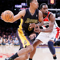 21 March 2014: Los Angeles Lakers forward Nick Young (0) drives past Washington Wizards forward Martell Webster (9) during the Washington Wizards 117-107 victory over the Los Angeles Lakers at the Staples Center, Los Angeles, California, USA.