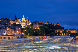 Waverley Station roof, Bank of Scotland and urban skyline, Scotland, Edinburgh, UK
