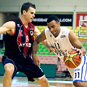 Anadolu Efes's Joshua Shipp (R) and Ted Kolej's Kirk Penney (C) during their Turkish Basketball League match Anadolu Efes between Ted Kolej at the Ayhan Sahenk Arena in Istanbul, Turkey on Sunday, 31 March, 2013. Photo by TURKPIX