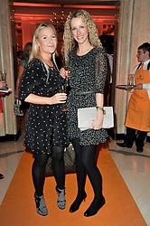 Left to right, LUCY MYNERS and KATE FREUD at the 38th Veuve Clicquot Business Woman Award held at Claridge's, Brook Street, London W1 on 28th March 2011.