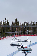 Chair Lift. People skiing and preparing to ski at Keystone Ski Resort, Keystone, Colorado, USA.