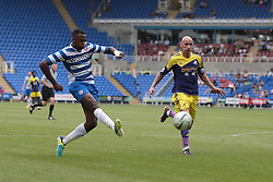 Reading midfielder Hope Akpan (16) has a shot on goal during the pre-season friendly game between Reading and Swansea City.  Photo mandatory by-line: Nigel Pitts-Drake/JMP  - Tel: Mobile:07966 386802 27/07/2013 - Reading v  Swansea City  - SPORT - FOOTBALL - pre-season - Reading - Madejski Stadium