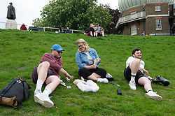 © Licensed to London News Pictures 28/05/2021. Greenwich, UK. People out in Greenwich Park in London this afternoon enjoying the warm weather and looking forward to a hot May bank holiday weekend. Photo credit:Grant Falvey/LNP