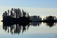 Silhouetted island in Rose Harbour at sunrise, Haida Gwaii National Park Reserve, Queen Charlotte Islands, BC, Canada