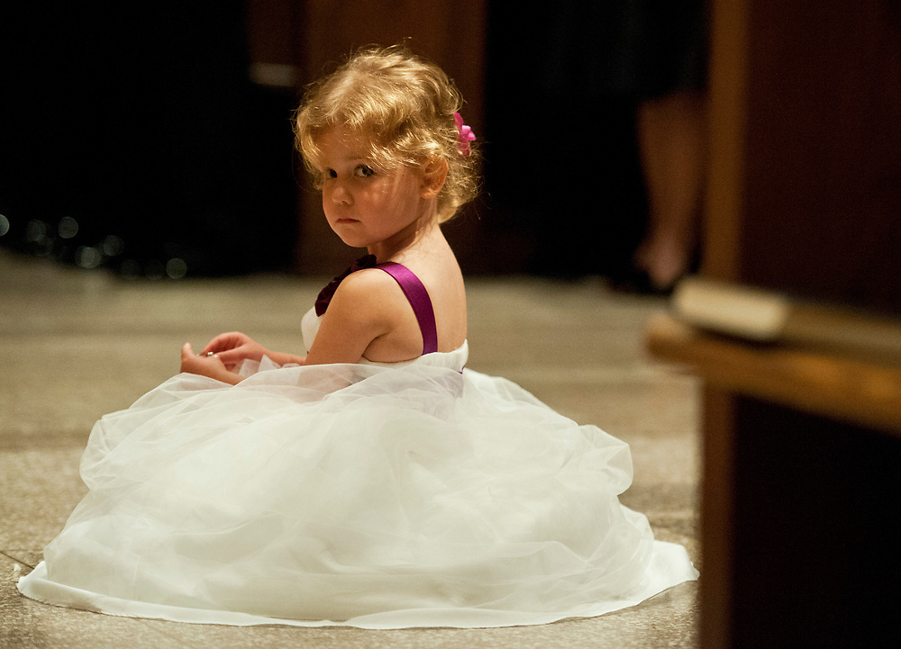Flower girl takes a break from her duties during a Boston College wedding.