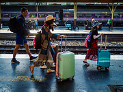 11 APRIL 2018 - BANGKOK, THAILAND:  People arriving in Bangkok get off the overnight train from Chiang Mai at Hua Lamphong train station in Bangkok on the first day of the Songkran travel period. Songkran is the traditional Thai New Year and is one of the busiest travel periods of the year as Thais leave the capital and go back to their home provinces or resorts in tourist areas. Trains and busses are typically jammed the day before the three day Songkran holiday starts. The government has extended the official holiday period through Monday, 16 April because one day of the Songkran holiday fell on the weekend, giving many workers a five day holiday.     PHOTO BY JACK KURTZ