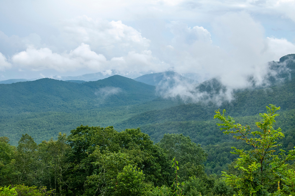 Clouds cling to the mountains at the Cradle of Forestry Overlook at Milepost 411 on the Blue Ridge Parkway in North Carolina on Friday, August 14, 2020. Copyright 2020 Jason Barnette