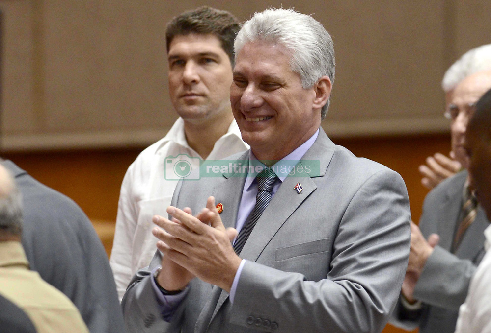 April 18, 2018 - Havana, Cuba - Cuban First Vice President MIGUEL DIAZ-CANEL (C) attends a session of Cuba's National Assembly of People's Power, in Havana. Cuba's parliament has picked Miguel Díaz-Canel as the sole candidate to succeed Raul Castro, 86, bringing the family's decades-long rule to an end. (Credit Image: © Joaquin Hernandez/Xinhua via ZUMA Wire)