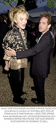 Actor TOM HOLLANDER and MRS DAPHNE NIARCHOS at a dinner in London on 21st May 2001.	OOK 42