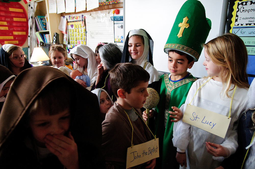 """Second grade students at St. Michael School in Orland Park gather for a group portrait after personifying their favorite religious figures during the school's annual Parade of Saints, February 2. During the event, costumed students stand motionless in the school commons for parents, grandparents and friends to """"activate"""" the Saint, who will offer a brief historical description. The session is followed by a parade through the school. l Brian J. Morowczynski~ViaPhotos..For use in a single edition of Catholic New World Publications, Archdiocese of Chicago. Further use and/or distribution may be negotiated separately. ..Contact ViaPhotos at 708-602-0449 or email brian@viaphotos.com."""