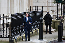 London, UK. 16 December, 2019. Mark Spencer, Chief Whip, walks between 9 and 10 Downing Street on the day of a small Cabinet reshuffle following the Conservatives' general election victory.