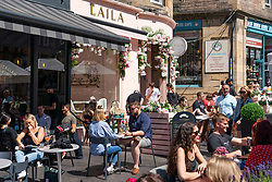 Edinburgh, Scotland, UK. 1 July  2021. Warm temperatures and sunshine attracted many members of the public to Edinburgh's outdoor cafes and bars and to the new St James Quarter shopping mall which opened last week. Pic; Outdoor cafes and bars, such as Laila,  on Cockburn Street were busy. Iain Masterton/Alamy Live News