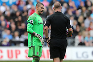 Victor Valdes, the Middlesbrough goalkeeper chats to referee Robert Madley. Premier league match, Swansea city v Middlesbrough at the Liberty Stadium in Swansea, South Wales on Sunday 2nd April 2017.<br /> pic by Andrew Orchard, Andrew Orchard sports photography.
