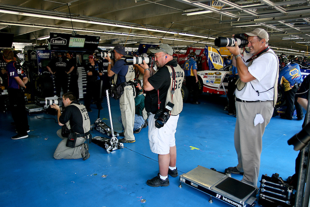 May 24, 2012; Concord, NC USA; NASCAR Sprint Cup Series photographers in the garage during  for the Coca-Cola 600 at Charlotte Motor Speedway. Photo by Kevin Liles/kevindliles.com