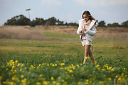 Preteen of 12 walks in a spring field