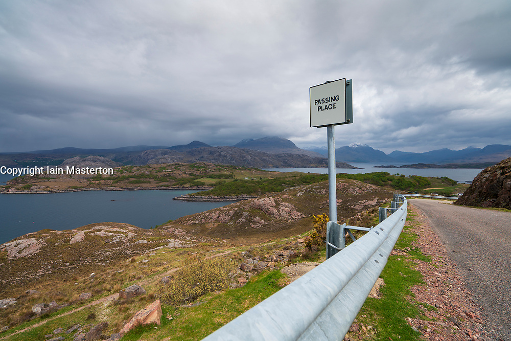 Single track road and passing place in Torridon on  the North Coast 500 scenic driving route in northern Scotland, UK