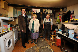 Leader of the Conservative Party David Cameron laughs  with Eileen and Jim Lawson of Lawsons Haulage Ltd, after their home and business were hit by the recent floods in Cockermouth, Cumbria. Thursday 17, 2009. Photo By Andrew Parsons ..Free for personal use only. No sales, no commercial use.