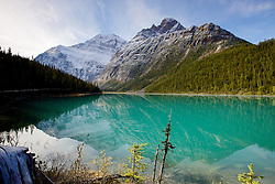 Cavell Lake with  Mt. Edith Cavell reflection upon it's emerald colored water.  Jasper National Park