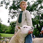 Son of Bransdale hill farmer Robert Myers shows a Texel ewe at Farndale Show, North York Moors, North Yorkshire, UK