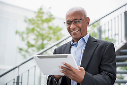 Man African holding tablet PC computer portrait
