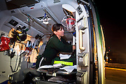Yvonne Kager organizes the medical gear in the back of the LifeFlight helicopter.