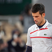 PARIS, FRANCE October 07.  Novak Djokovic of Serbia during his match against Pablo Carreno Busta of Spain in the Quarter Finals of the singles competition on Court Philippe-Chatrier during the French Open Tennis Tournament at Roland Garros on October 7th 2020 in Paris, France. (Photo by Tim Clayton/Corbis via Getty Images)
