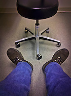 a day at the clinic showing feet and a chair while waiting for an appointment