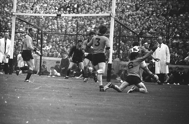 Down defend well as Kerry forward L Prendergast kicks the ball surrounded by Down defenders but ball went wide during the All Ireland Senior Gaelic Football Final Kerry v Down in Croke Park on the 22nd September 1968. Down 2-12 Kerry 1-13.