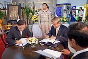 Sept. 22, 2009 -- BANGKOK, THAILAND: Thai government officials sign get well notes  in the lobby of Siriraj Hospital for King Bhumibol Adulyadej, the 81-year-old King of Thailand. The King has been admitted to hospital suffering from a fever. Doctors at Siriraj Hospital said the world's longest-serving monarch, had shown signs of fatigue and was being treated with antibiotics. King Bhumibol is deeply revered by most Thais and his health is a matter of public anxiety. His Majesty was admitted on Saturday suffering from a fever, fatigue and loss of appetite. Doctors continued to treat the King with intravenous drips and antibiotics, hospital officials said. More than 3,500 people have come to the hospital to pray for the King's speedy recovery and to sign get well cards for him.  Photo by Jack Kurtz