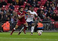 Football - 2017 / 2018 Premier League - Tottenham Hotspur vs. Liverpool<br /> <br /> Mohamed Salah (Liverpool FC)  forces his way past Serge Aurier (Tottenham FC)  at Wembley Stadium.<br /> <br /> COLORSPORT/DANIEL BEARHAM