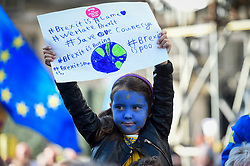 © Licensed to London News Pictures. 20/10/2018. LONDON, UK. A young girl takes part in the march.  Thousands of people take part in a demonstration, organised by the People's Vote campaign, beginning with a march from Park Lane to a rally in Parliament Square.  The People's Vote seeks a referendum on the outcome of the final Brexit negotiations ahead of 29 March 2019, the date that the UK is due to leave the EU.  Photo credit: Stephen Chung/LNP