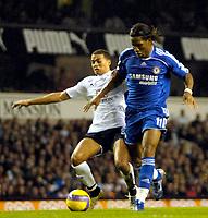 Photo: Ed Godden.<br /> Tottenham Hotspur v Chelsea. The Barclays Premiership. 05/11/2006. Spurs' Jermaine Jenas (L) cathes up with Didier Drogba.