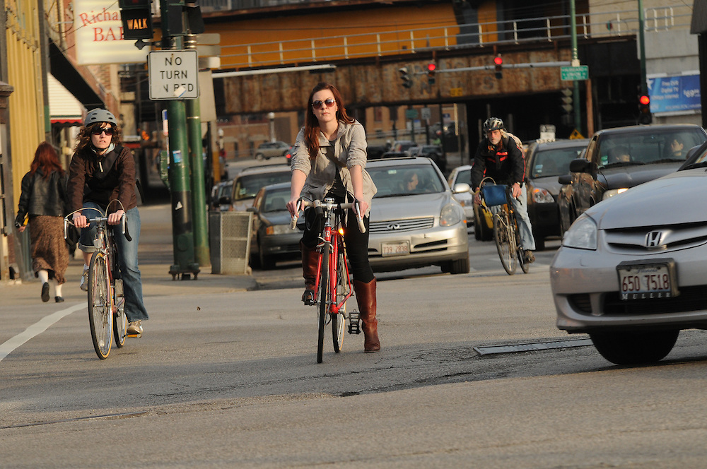 Biker Dana Hammett heads north on Milwaukee Avenue during her commute home to Ukranian Village, a task she was once too intimidated to attempt. She now counts herself among the bike commuter crowd,  comfortable weaving among rush hour traffic. She even finds that a bike ride home can be faster than a car or public transportation at times.