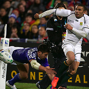 Bryan Habana, South Africa, gets the ball away as Paul Williams, Samoa, attempts a tackle during the South Africa V Samoa, Pool D match during the IRB Rugby World Cup tournament. North Harbour Stadium, Auckland, New Zealand, 30th September 2011. Photo Tim Clayton...